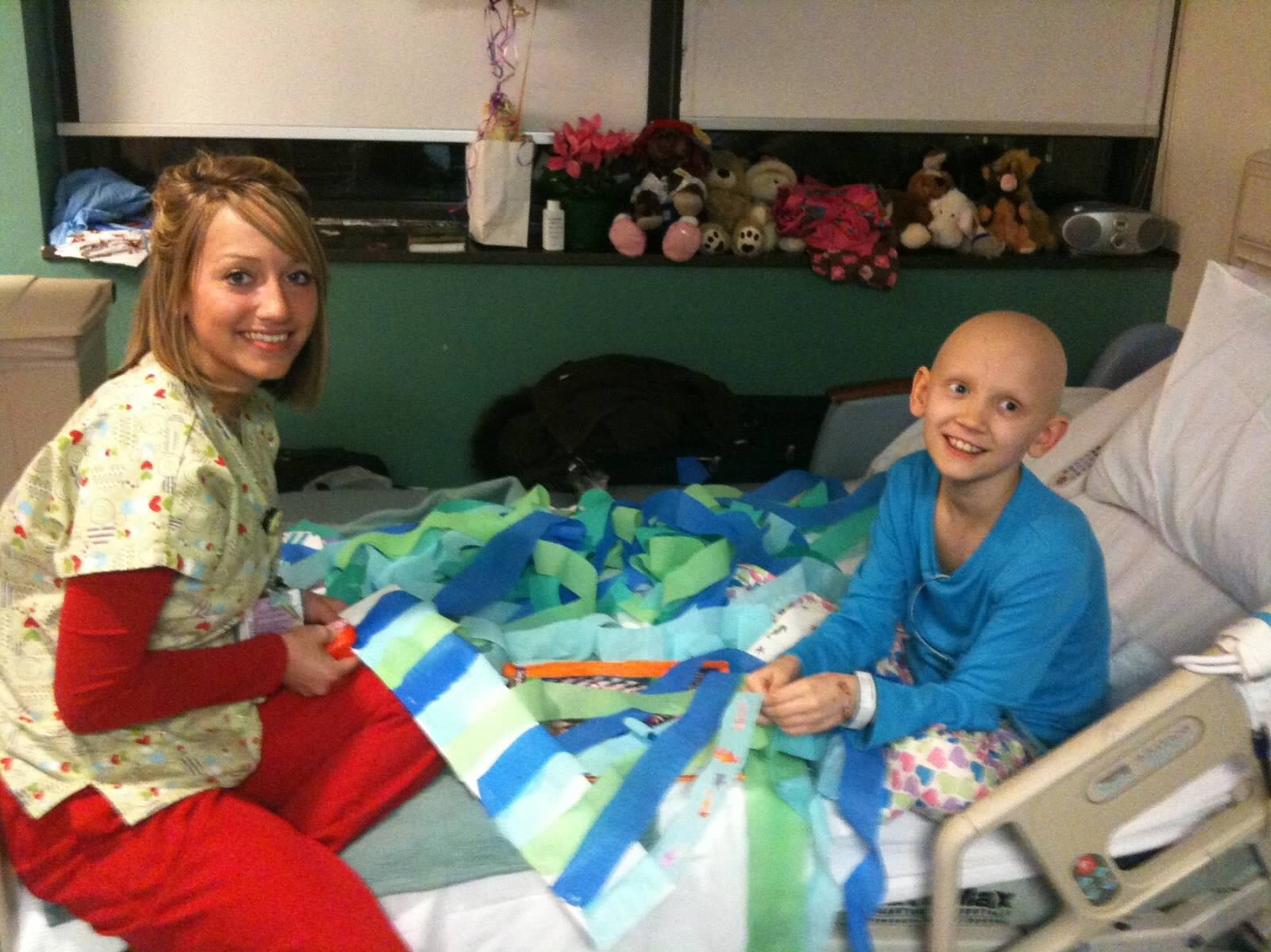 Abbie doing school project in the hospital with the help of one of her favorite nurses--homework waits for noone