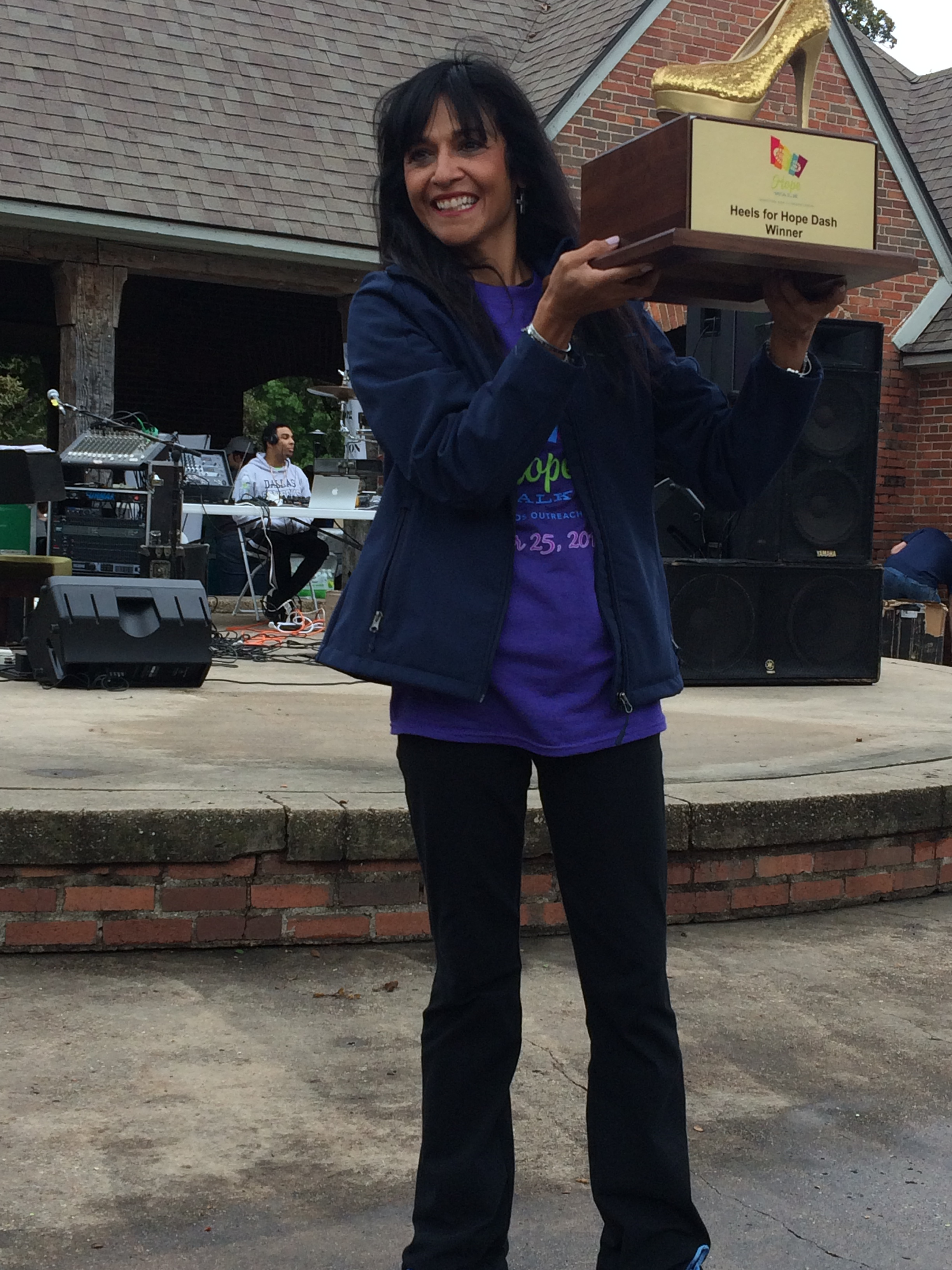 Dr. Di holding the Hope for Heels Trophy