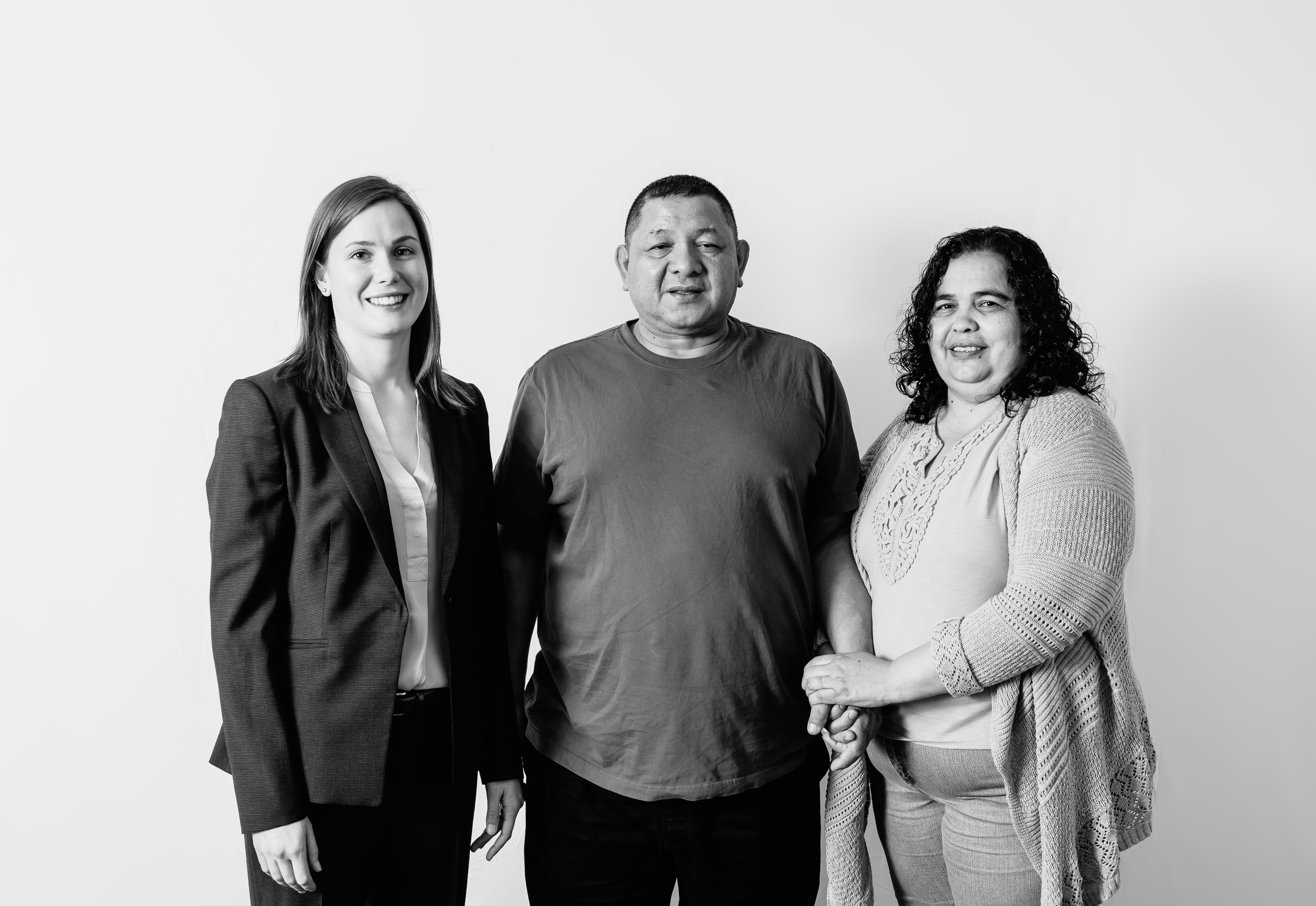 Wilmar and Alba Funes with Legal Aid attorney Jenny Joseph