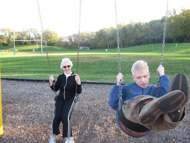 Johnny swinging with Grandma