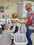 TASC Client, Bruce doing laundry with TASC Coordinator, Diana