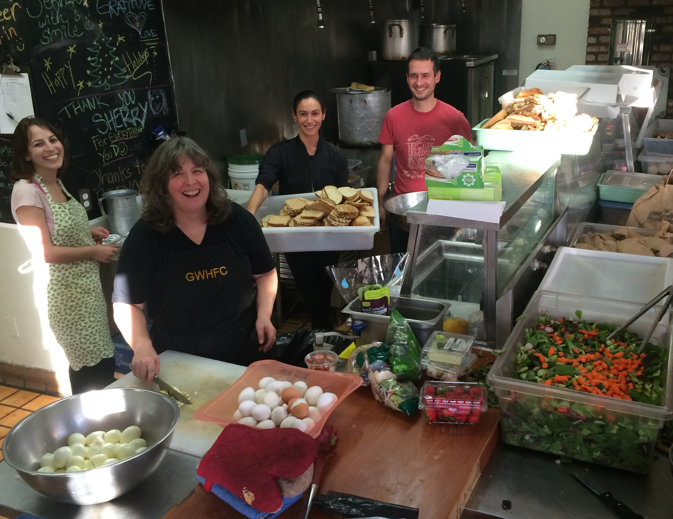 Volunteers making magic in GWHFC's rented kitchen