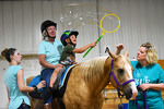 Horse therapy helps builds muscle control and coordination while playing fun games